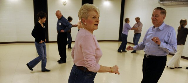 Shirley Barrand  counts out the steps as she and husband Blue teach a dance class.