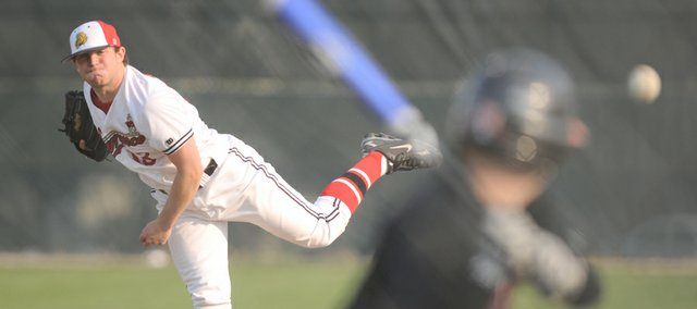 Lawrence High pitcher Albert Minnis delivers a pitch to Shawnee Mission Northwest batter Nick Finer during the first inning. Minnis gave up two hits and stuck out 12 in the Lions' 2-0 victory Tuesday at Ice Field.