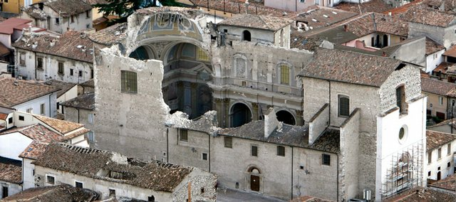 Santa Maria Paganica church in L'Aquila, central Italy, is seen Tuesday in an aerial view, a day after a powerful earthquake struck the Abruzzo region. The death toll from Italy's worst earthquake in three decades jumped to 235 as bodies were recovered and identified. Fifteen people are missing.