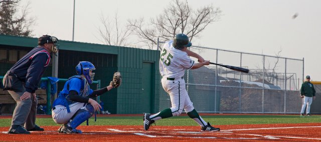 Free State's Michael Lisher hits a double in the fourth inning against Olathe Northwest. Free State won, 4-2, on Tuesday at home.