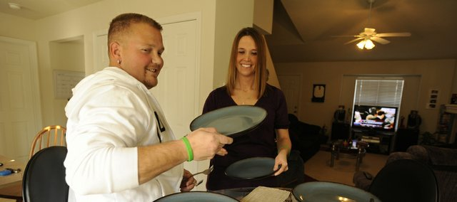 Amy Kennedy and her fiance, Logan Hastings, enjoy an evening together. Logan Hastings is recovering from a rare kidney transplant. Kansas University Hospital surgeons transplanted the kidneys of a 3-year-old child into Logan on Dec. 29. They expect Logan to live a better and longer life thanks to the gift.