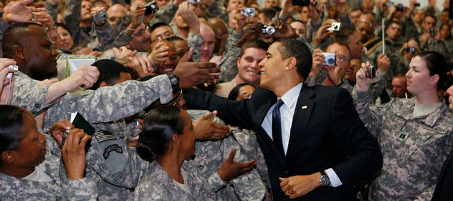 President Barack Obama greets military personnel Tuesday at Camp Victory in Baghdad during a surprise visit to the country.