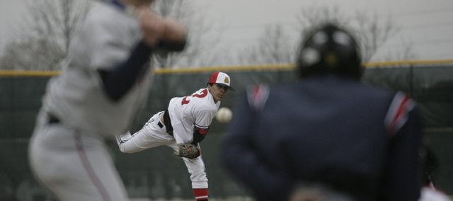 Lawrence's Dorian Green delivers a pitch during a game against Olathe North on April 9 at Ice Field.