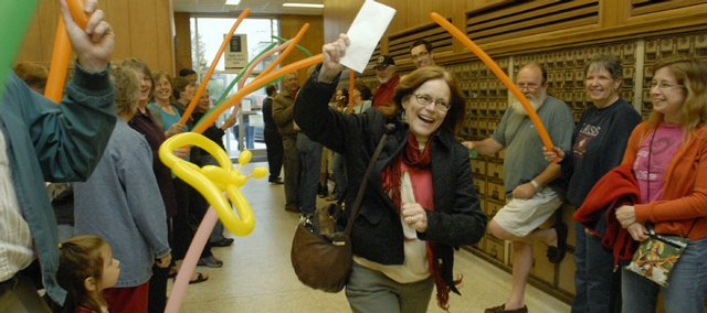Kathi Firns-Hubert of Lawrence enjoys the scene at a tax party event at the Lawrence Post Office in 2007. The annual party, on April 15, honors all of those who put off their taxes until the last minute.