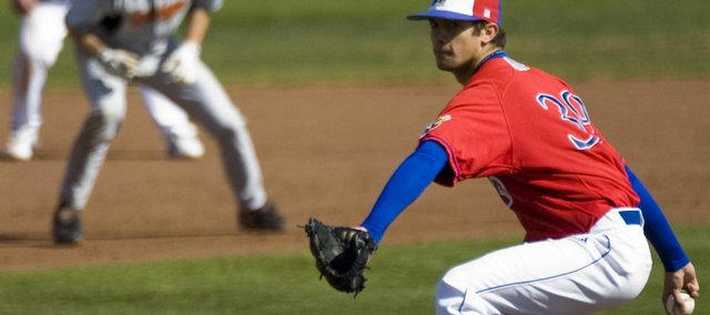 KU pitcher T.J. Walz delivers a pitch against Oklahoma State on April 11.
