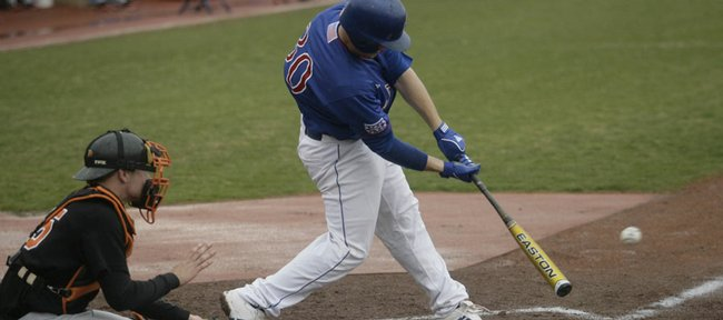 Kansas University's Buck Afenir reaches down to get after a pitch during the game against Oklahoma State on Sunday, April 12, 2009, at Hoglund Ballpark. Afenir hit the pitch, driving in a pair of Jayhawks and giving KU a 2-1 lead early in the game.