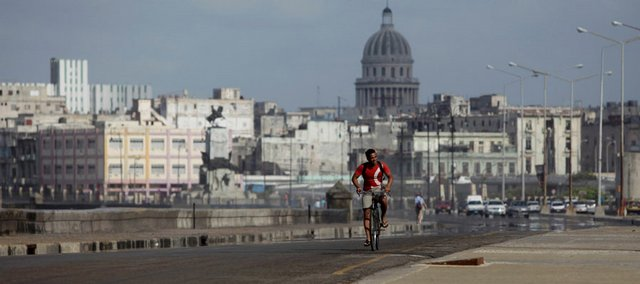 A man rides his bicycle along the Malecon in Havana in this photo from Tuesday, April 9, 2009. A push in Congress to do away with U.S. travel bans on Cuba could set off a flood of American visitors to the long-forbidden island. Despite the global economic downturn, international visitor rates have increased 4.5 percent through February as compared to the first two months of 2008.