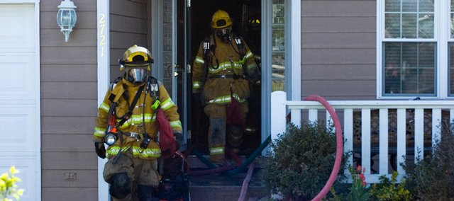 Fire crews were checking the inside of a house fire Saturday at 2721 Lankford.