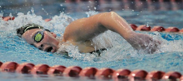Free State junior Morgan Flannigan races to a second-place finish in the 500 freestyle event. Flannigan and the Firebirds edged Lawrence High to win the Free State Invitational on Tuesday at the Lawrence Indoor Aquatic Center.