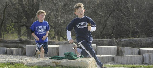 Michael Gard, 9, leads fellow classmate Cooper Catlin, 9, both Langston Hughes School students, in a sprint to the finish line Friday at Fred DeVictor Park. Langston Hughes and Quail Run School students participated in a fun run on Friday and also collected running shoes and canned food.