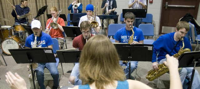 "Mary Huntimer, graduate teaching assistant at Kansas University, directs students in the KU Jazz Ensemble III class rehearsal of  ""Blues Du Jour"" on Friday in Murphy Hall. The state's revenue forecast was revised downward on Friday by nearly $330 million, and lawmakers will have to make further budget cuts or other adjustments when they return for their wrap-up session later this month. Education and social services may have to tighten their belts even more if Republicans have their way."