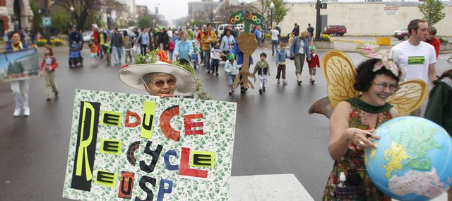 Nelda Leibig, left, heads towards South Park along side her daughter, Beth Merryfield, right, during the 2009 Earth Day Celebration parade on Massachusetts Street. Leibig and Merryfield dressed up as Mother and Daughter Earth to participate in the parade and Earth Day celebrations Saturday.