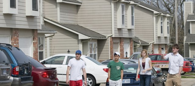 From left, Kansas University sophomores Matt Johnson, Salina; Chris Lou, Chicago; and Tucker Allred, Salina, far right, tour Sunrise Village on Friday, looking at apartments with manager Amber Allen. With Lawrence full of apartment and townhouse complexes, the rental market is competitive. Many are offering move-in incentives, but overall rent is not going down here.