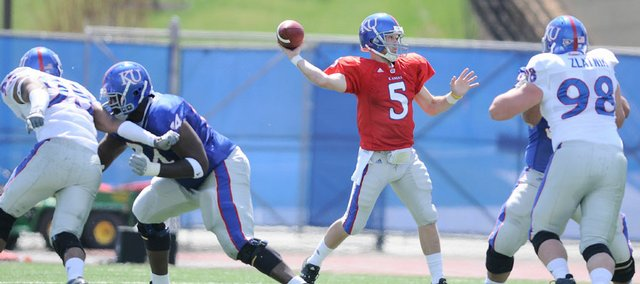 Blue team quarterback Todd Reesing pulls back to throw during the first half of the 2009 Spring Game Saturday, April 11, 2009 at Memorial Stadium.