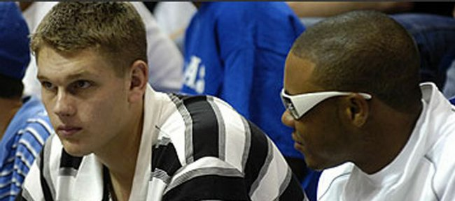 Minnesota high school standout Cole Aldrich, left, sits with former KU recruit C.J. Henry during the 2005 Late Night in the Phog. Henry will join up with Aldrich as a member of the Jayhawks next season.