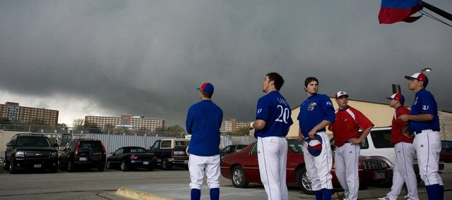 Kansas baseball players watch the storm pass over Daisy Hill. Saturday night's Kansas University baseball game against Nebraska was postponed because of weather. The two teams will play a double header Sunday beginning at 11 a.m. at Hoglund Ballpark.
