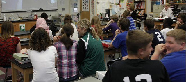 Students in a 9th grade biology class at Southwest Junior High School participate in a virtual classroom. Lawrence school Supt. Randy Weseman said statewide budget cuts could lead to layoffs or reductions in services.