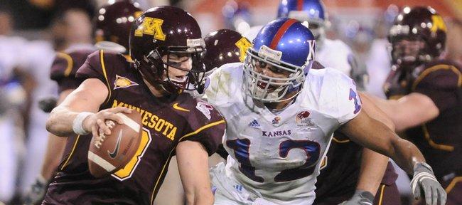 Kansas linebacker James Holt chases Minnesota quarterback Adam Weber during the fourth quarter of the Insight Bowl Wednesday, Dec. 31, 2008 at Sun Devil Stadium in Tempe, Arizona.
