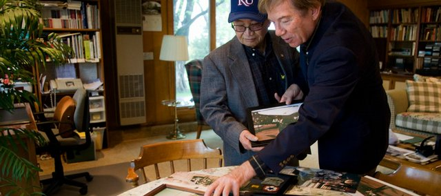 Reunited friends Gene Kean, right, and Anh Vo look through some of Kean's memorabilia from his military years Monday at Kean's house in Lawrence. Kean is a retired U.S. Army first lieutenant and Vo is a retired lieutenant colonel who fought against the Vietcong with the South Vietnamese army during the Vietnam War. The two met in 1958 when Vo was being trained by the U.S. Army at Fort Belvoir, Va.Vo found Kean by way of the Internet, and the two reunited Saturday for the first time in 50 years.