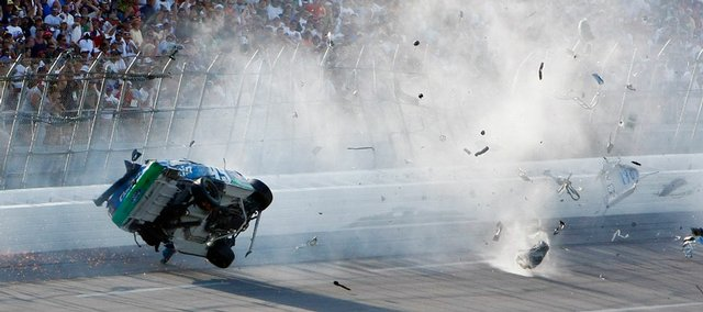 Carl Edwards' car leaves a trail of debris after it went airborne and hit the catch fencing on the final lap of the Aaron's 499 on Sunday in Talladega, Ala. Despite the crash injuring several fans, NASCAR said it was satisfied with its current safety standards.