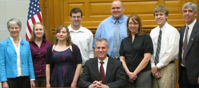 The KU debate champions were honored in Topeka on Wednesday.