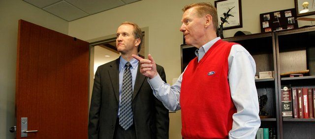 Alan Mulally, CEO of Ford Motor Co., right, discusses the future of his company with Stuart Bell, Kansas University's dean of engineering, Wednesday in Bell's office. Mulally visited his alma mater and met with KU students at Eaton Hall.