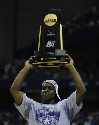 Kansas' Sherron Collins hoists the trophy on Monday, April 7, 2008 at the Alamodome in San Antonio, Texas.