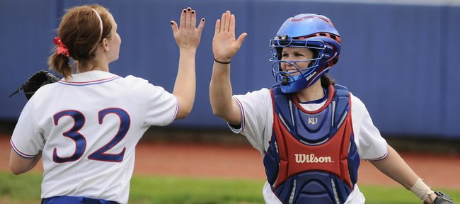 Kansas pitcher Valerie George gets a high five from catcher Elle Pottorf after George struck out a Texas A&M batter to end the second inning Thursday, April 30, 2009 at Arrocha Ballpark.