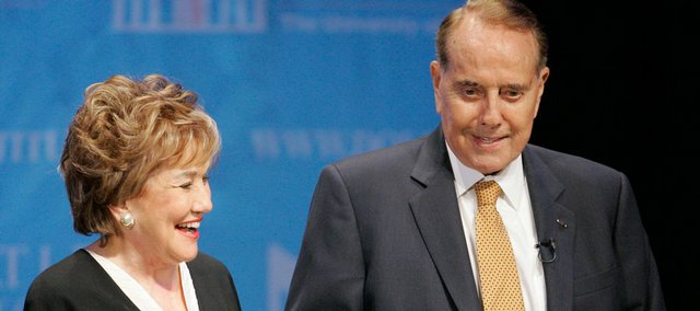 Former U.S. Sens. Elizabeth and Bob Dole are introduced at the Lied Center on Kansas University's West Campus. The Doles spoke in the Dole Lecture Series on Sunday.