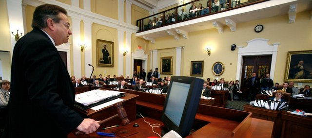 Sen. Lawrence Bliss, D- South Portland, pounds the gavel in the Senate chamber giving final approval to a gay rights marriage bill at the State House in Augusta, Maine, on Wednesday, May 6, 2009. Maine's Gov. John Baldacci later signed the bill.