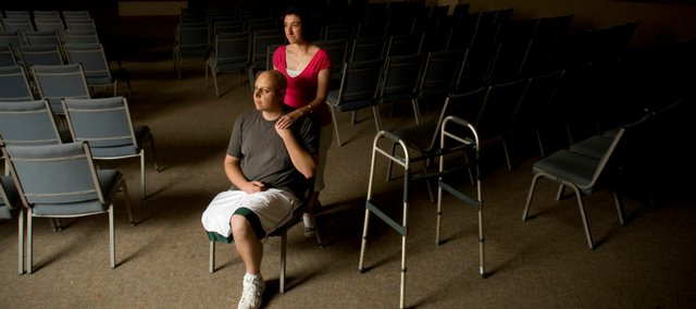 Brandon white and his wife, Jody, are shown in the sanctuary of Heartland Community Church, 619 Vt., in this July 8, 2008, file photo. Brandon White, 29, who was the youth pastor at the church, died Wednesday morning at Kansas University Hospital after a battle with bone cancer.