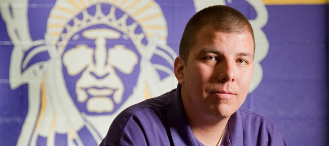 Elwood Ott will get his diploma from Haskell Indian Nations University on Friday. Ott, a father of two and a basketball coach at Haskell, balanced his family life and work and managed to graduate, becoming the first person in his family to do so.