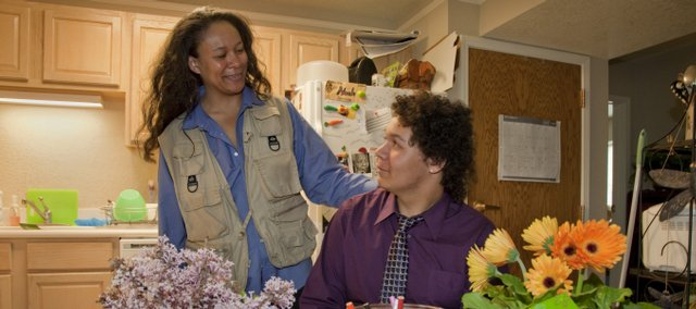 Angela Lindsey-Nunn works at home with her son, Noah Nunn, before dinner at Stouffer Place Apartments on Kansas University campus. Lindsey-Nunn is a single mother and graduate student in social welfare.