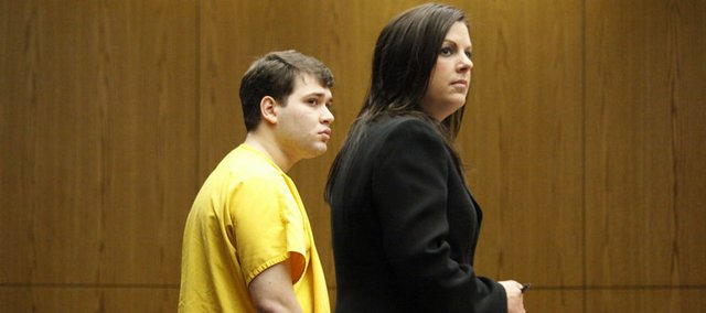 Cem Basoflas stands with his lawyer during his sentencing at the Douglas County Courthouse Friday, May 8, 2009.