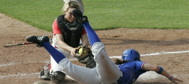 Iowa State catcher Alex Johnson, left, tags out Kansas baserunner Liz Kocon in the second inning. The Cyclones beat the Jayhawks, 2-0, in the Big 12 Championship on Friday in Oklahoma City.