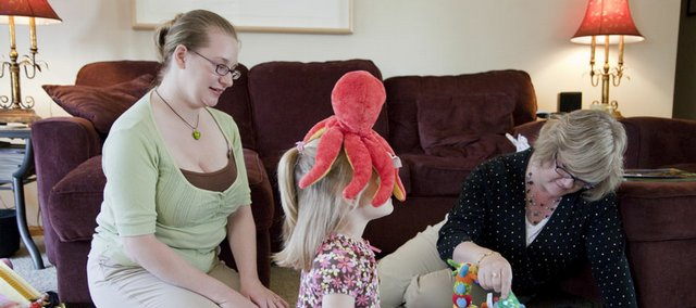 Kim Cooper, left, mother of Marguerite, 5, center, and 4-month-old Patricia, right, spend some time at the home of Cooper's mother, Brenda Childers, on Thursday. Cooper has gained a new appreciation of her mother since becoming a mom to her two young girls.
