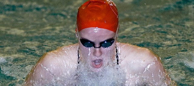 Lawrence High's Emma Reaney competes in the 100-yard breaststroke final. Reaney won that event and the 200 IM Saturday at the Sunflower League meet at Olathe California Trail Junior High.