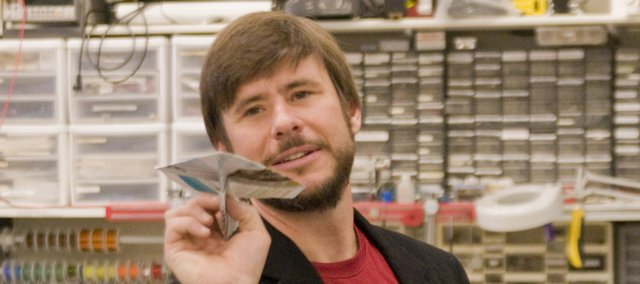 Ron Barrett-Gonzalez, associate professor of aerospace engineering at Kansas University, constructs a paper airplane. To help celebrate the Lawrence Municipal Airport's 80th anniversary in May, The World Company is sponsoring a paper airplane contest. Barrett offers some tips for those looking for an edge at the contest.