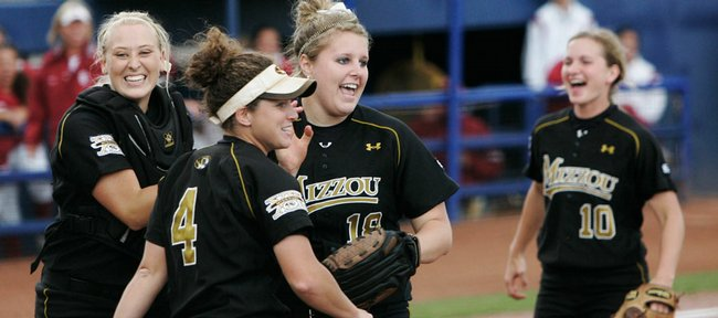 Missouri pitcher Chelsea Thomas, center, celebrates with teammates at the end of the the Big 12 softball tournament championship game against Oklahoma, in Oklahoma City, Sunday, May 10, 2009. Thomas pitched two-hit shutout as Missouri defeated top-seeded Oklahoma 5-0 to win its first Big 12 softball title in 12 years. From left to right, Megan Christopher, Gina Schneider, Thomas and Abby Vock.