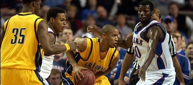 """Omar Wilkes began his college career as a KU guard then transferred to Cal after playing sparingly during the 2003-04 season. Wilkes, who has filmed some commercials, worked as an assistant to the production team on the Will Smith movie, """"Hancock."""" In this December 11, 2005, file photo, he looks for help while pressured by Brandon Rush, second from left, and Julian Wright, as Cal's DeVon Hardin (35) looks to lend a hand."""
