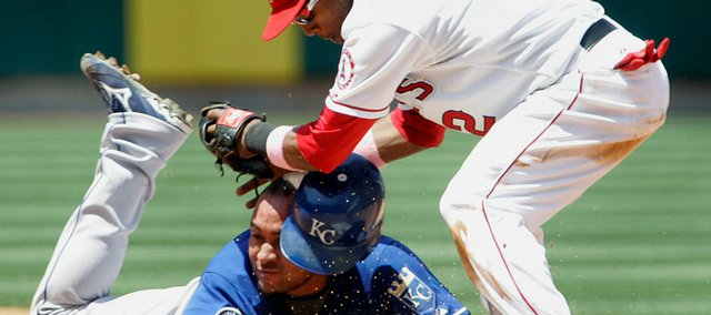 Kansas City's Miguel Olivo slides safely into second base as Los Angeles shortstop Erick Aybar can't make the tag in time in the fourth inning. The Angels beat the Royals, 4-3, on Sunday in Anaheim, Calif.