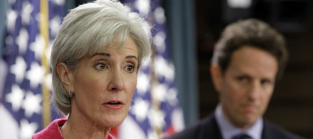 Health and Human Services Secretary Kathleen Sebelius is shown with Treasury Secretary Timothy Geithner.