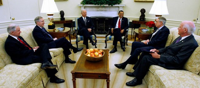 Vice President Joe Biden and President Barack Obama, center, meet with senators Wednesday in the Oval Office of the White House in Washington to discuss the Supreme Court appointment. From left are Sen. Jeff Sessions, R-Ala., ranking Republican on the Senate Judiciary Committee; Senate Minority Leader Mitch McConnell of Ky.; the vice president; the president; Senate  Majority Leader Harry Reid of Nev.; and Senate Judiciary Committee Chairman Sen. Patrick Leahy, D-Vt.