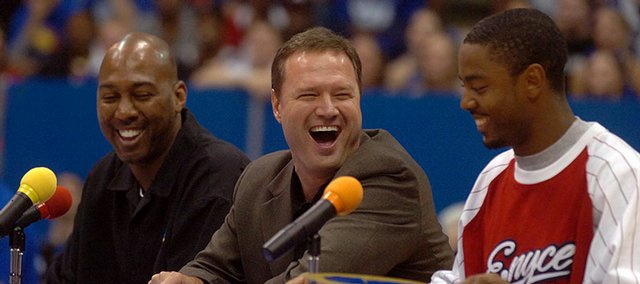 From left, Danny Manning, Bill Self and Aaron Miles crack jokes during Late Night at Allen Fieldhouse in this October 13, 2006, file photo.