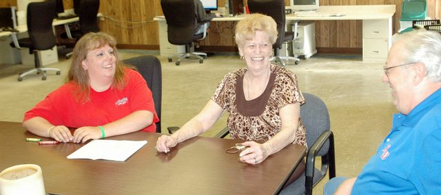 Sherry Lawrence, center, will receive her high school diploma today at the Eudora Community Learning Center. She visited with the learning center's coordinator, Angie Miller, at left, and her husband, Norm, at right.