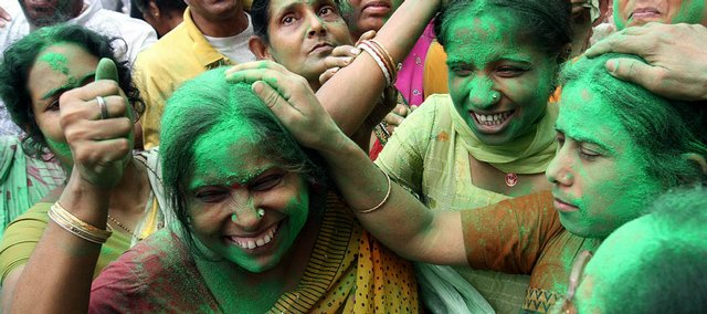 Trinamool Congress party supporters celebrate with colored powder in front of the residence of their party leader Mamata Banerjee on Saturday in Calcutta, India.India's governing Congress party was headed to a resounding victory Saturday in the monthlong national elections, media reports said, setting off celebrations and claims of success by party leaders. The Trinamool Congress is an ally of the Congress party.