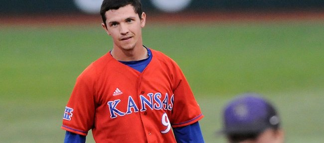 Kansas runner Brian Heere takes off his helmet at second base after being forced out by Kansas State shortstop Drew Biery during the first inning Friday, May 15, 2009 at Tointon Family Stadium in Manhattan.