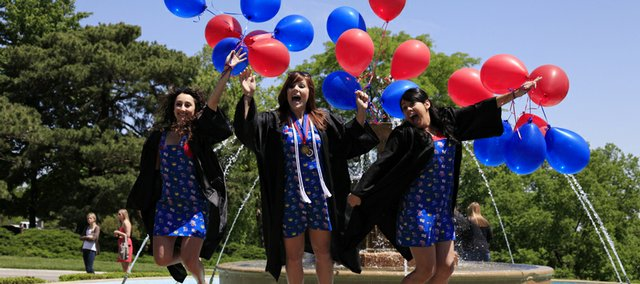 Irina Yakhnis, Amanda McIntosh and Melissa Galaviz took to the Chi Omega fountain before KU's graduation for a picture to share with friends. Kansas University's 137th commencement on Sunday found friends and family members celebrating graduation at Memorial Stadium in perfect weather conditions.