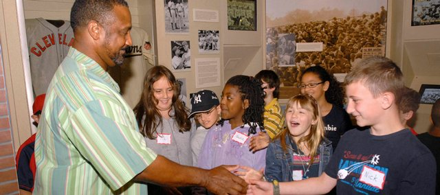 Baseball Hall of Fame 2009 inductee Jim Rice greets fourth-graders during a tour of the National Baseball Hall of Fame on Friday in Cooperstown, N.Y.