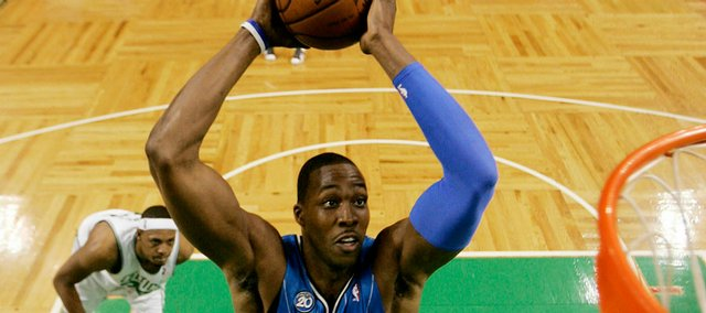 Orlando's Dwight Howard goes in for the dunk in front of Boston's Paul Pierce. The Magic won, 101-82, on Sunday in Boston.